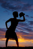 Silhouette woman with hat on hand Stock Photos