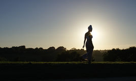 Silhouette of woman in headscarf walking in nature Royalty Free Stock Photography