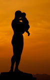 Silhouette of a woman with her baby Royalty Free Stock Photos