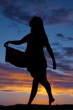 Silhouette woman hold out skirt side Stock Photography