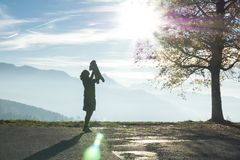 Silhouette of Woman Holding Baby Near the Swiss Alps Stock Photos
