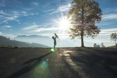 Silhouette of Woman Holding Baby Up in Silhouetted Mountains Stock Photos