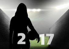 Silhouette of woman holding ball forming 2017 new year sign 3D Stock Image
