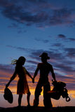 Silhouette of woman holding hat back wind cowboy Stock Photography