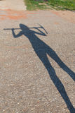 Silhouette of a woman holding a pickax Stock Photography