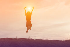 Silhouette of woman jumping against beautiful sky Stock Image
