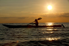 Silhouette of woman kayaking Royalty Free Stock Image