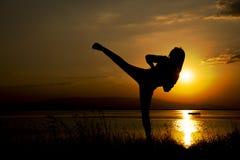 Silhouette woman kick training stock photo
