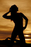 Silhouette woman on knees look side Royalty Free Stock Photography
