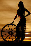 Silhouette woman lace skirt wagon wheel side Royalty Free Stock Image