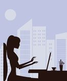 Silhouette of woman with laptop Stock Photo