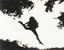Silhouette of woman leaping in mid-air Royalty Free Stock Image