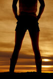 Silhouette woman legs cowgirl back hands hips Royalty Free Stock Photography