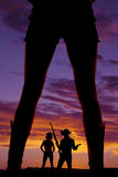Silhouette woman legs cowgirl with boots Royalty Free Stock Image