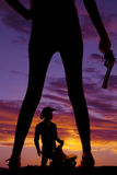 Silhouette woman legs gun in hand cowboy Stock Images