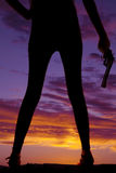 Silhouette woman legs gun in hand Royalty Free Stock Photos
