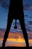Silhouette woman legs hammer between legs Royalty Free Stock Photos