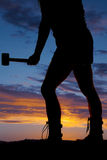 Silhouette woman legs hammer side Royalty Free Stock Photo