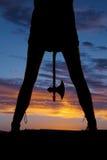 Silhouette woman legs hatchet between Stock Images