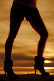 Silhouette woman legs heels facing side Stock Photo