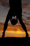Silhouette woman legs hold ball between legs Stock Images