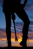 Silhouette woman legs holding wrench Royalty Free Stock Images