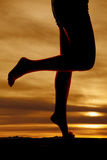 Silhouette woman legs kick back bare Stock Photo