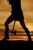 Silhouette woman legs side hatchet Royalty Free Stock Photography