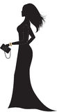 Silhouette of woman in long dress. Royalty Free Stock Photography