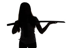 Silhouette of woman looking at blade Stock Photography