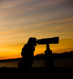 Silhouette of Woman Looking Through Telescope Royalty Free Stock Images