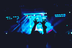 Silhouette of woman making hand gestures, vintage look on photo, stage and crowd background. Silhouette of a woman making hand gestures, vintage look on photo Stock Photos