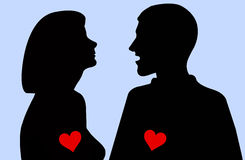 Silhouette of woman and man Stock Image