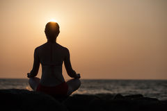 Silhouette of woman that meditates Royalty Free Stock Photo