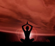Silhouette of a woman meditating on red. Astral meditation. Silhouette of a woman doing yoga exercise Royalty Free Stock Photos
