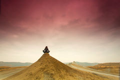 Silhouette of woman meditating on top of a hill. Royalty Free Stock Photos
