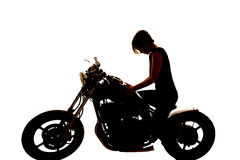 Silhouette woman motorcycle hands on tank look down Royalty Free Stock Images