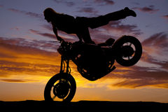 Silhouette woman motorcycle leg back tire up Stock Photo