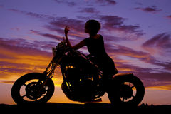 Silhouette woman motorcycle sit elbow on tank Stock Photography