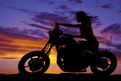 Silhouette of a woman on a motorcycle wind blowing Royalty Free Stock Image