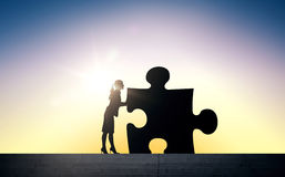 Silhouette of woman moving puzzle over sun light Stock Photos