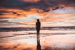 Silhouette of Woman Near Sea Shore Stock Photos