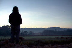 Silhouette of woman with nice sunrise Stock Photo