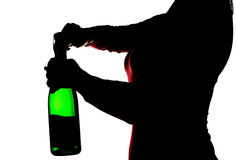 Silhouette of the woman opening champagne Royalty Free Stock Photography