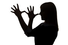 Silhouette of woman with palms on nose Stock Images