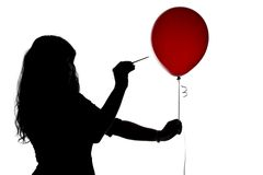 Silhouette of woman pierced with a needle balloon Stock Images