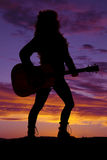 Silhouette of a woman playing a guitar Royalty Free Stock Images