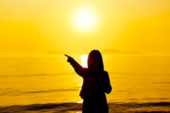 The silhouette of woman pointing at beach Stock Photography