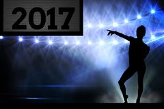 Silhouette of woman pointing at 2017 new year sign 3D. Silhouette of woman pointing at 2017 new year sign on stage 3D Stock Images