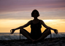 Silhouette of woman in position lotus Royalty Free Stock Photos